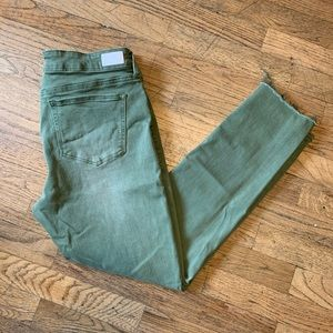 Olive distressed skinny jeans